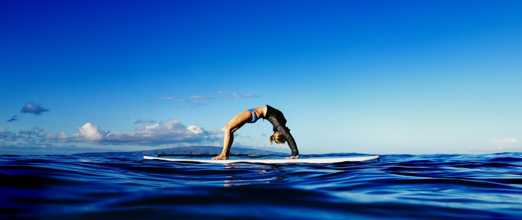 Wheel Pose on a surfboard